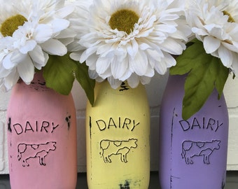 Pastel Pink, Yellow, and Purple Dairy Jars