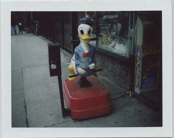 Original Donald Duck Coin Ride Polaroid