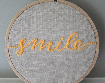 """Hand Embroidered 4"""" Hoop Wall Art Neon Orange Calligraphic """"Smile"""" Quote Saying on Natural Unbleached Linen"""