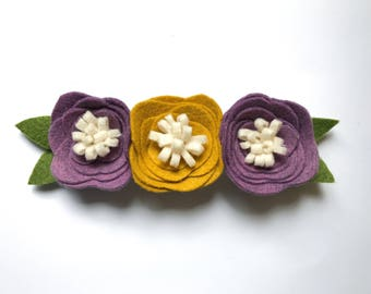 Purple and mustard flower trio