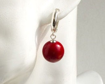 Earrings with a large red coral and sterling silver