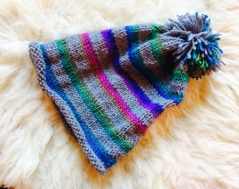 Hand knitted rainbow hat