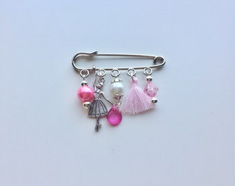 Silver dancer pin beads and pink tassel