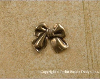Dapped Bow Charm in Antique Polished Brass (item 204-small AG) - 20 Pieces