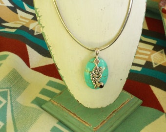 Turquoise sterling silver design necklace with garnet stone