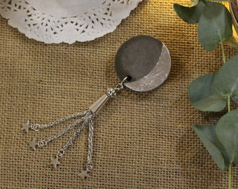 Original Moon in concrete with star brooch
