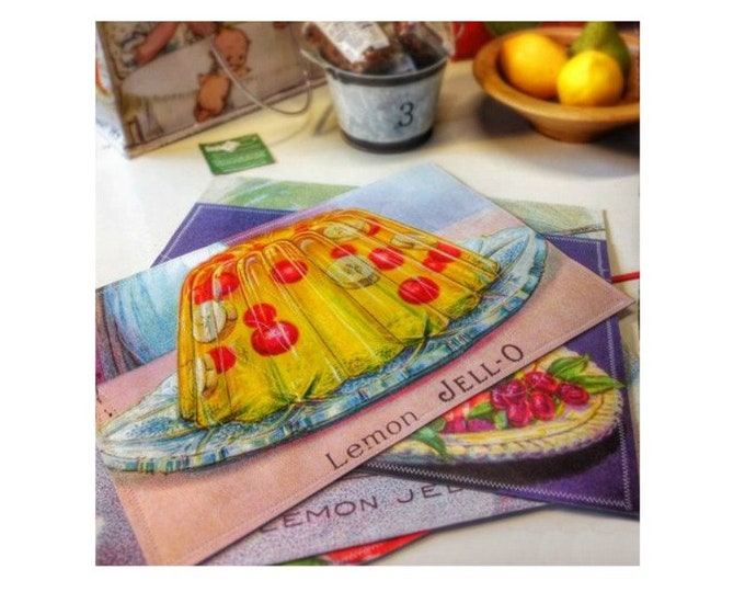 Set of six placemats with vintage Jell-O illustrations. Wipe clean, flexible.