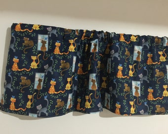 blue and yellow all over cats looking out window CATS window  valance