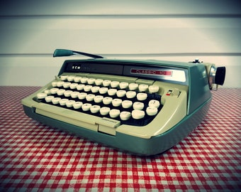Refurbished 1960s Smith Corona Green and creme white Typewriter, w/ Case and new ribbon