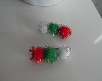 "Christmas: set of two crocodile clips decorated with multicolored ""leprechaun"" tassels"