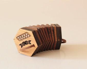 Concertina - accordion - a miniature copy - present - miniature musical instrument