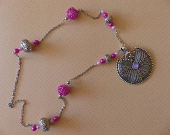 Long metal necklace with pendant metal and acrylic beads and rhinestones