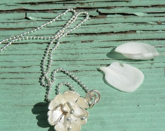 Handcrafted sterling silver flower head pendent