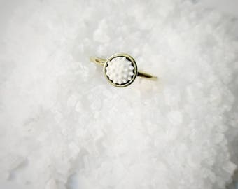 Brass and porcelain ring