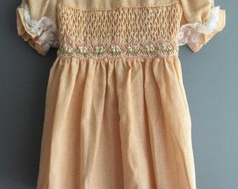 Vintage smocked peach Polly Flinders dress