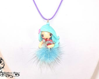 Doll made of polymer clay with blue tassel necklace