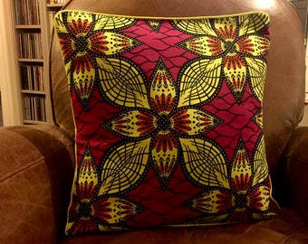 Cushion cover in yellow, Burgundy and orange wax
