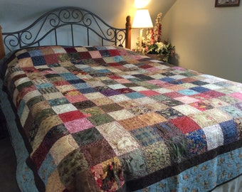 Queen Bed Quilt/Multi fall Colours/handmade/red floral backing/Lacey bubble custom quilting/feathered border quilting