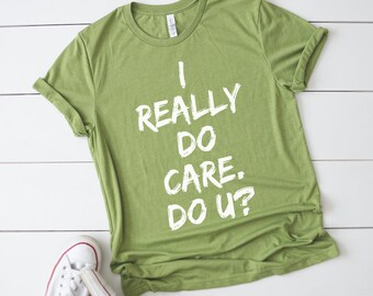 DONATE I really DO care, Do U Shirt Tee T-Shirt protest equality human rights immigrants resist anti trump, refugees, daca, Melania, asylum,