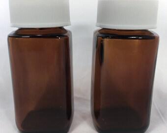 """2 Vintage SQUARE Amber MEDICINE BOTTLES wCaps 3.5"""" 2 oz 12 Tsp Glass Sani-glas Brown"""
