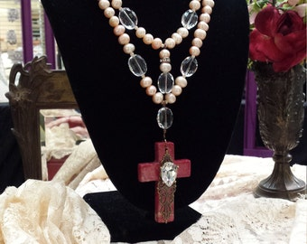 Two strand fresh water pearl and faceted crystal necklace with cross center drop