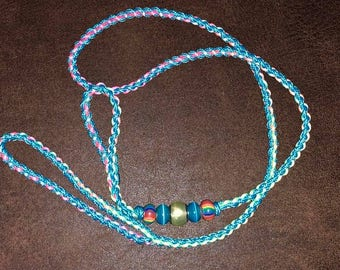 Rainbow Satin and Para-cord 36 inch show lead with glass and kiln fired pottery beads.