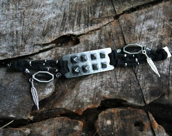 Spiked black faux leather bracelet