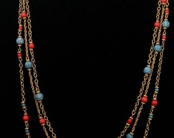 Multistrand beaded gold tone chain necklace
