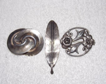 3 vintage brooches, sterling silver, geometric overlapping cirlcles, long leaf, open circles with floral leaf, Lanz, Mexico sterling