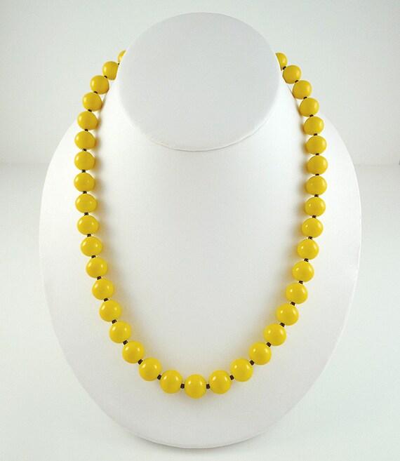 collier perle jaune