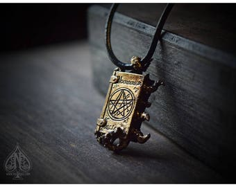 Necronomicon book tentacles aging bronze pendant