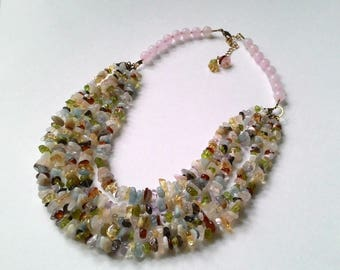 Multi strand necklace made of narutal stones.