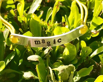 Magic adjustable cord bracelet - You choose metal and cord color.