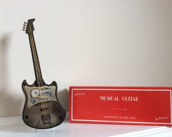 A Musical Guitar in the original box No.1002.