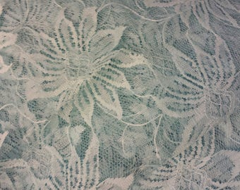 Blue scalloped lace fabric