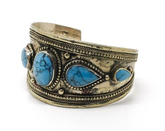 Cuff with inlaid stones bracelet