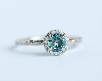 SOLD: Light Teal Montana Sapphire in White Gold Diamond Halo - Hand carved eclectic band sapphire engagement ring by Anueva Jewelry - Recycl