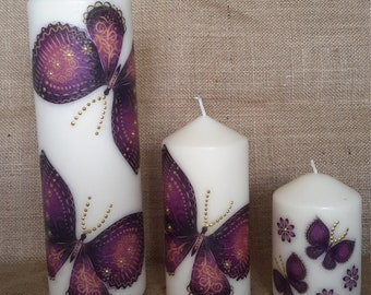 Set of three unscented decoupage candles.