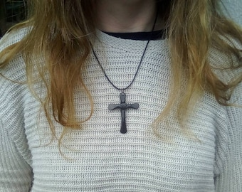 Hand forged cross. A classic Christian cross made from forged steel. Fitted to a leather necklace.