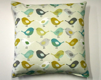 Scandinavian style bird cushion in mustard and teal