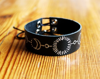 leather bracelet with silver drawing - moon phase