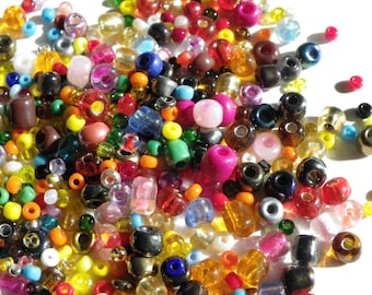 set of 2 mm seed beads has 4 mm random mix