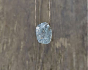 Rough aquamarine necklace. Raw icy blue aquamarine necklace on a brown silk thread. Rough slice aquamarine necklace. March Birthstone.
