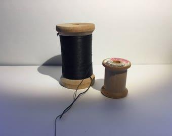vintage wood spools of thread