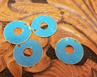 Four blue brass disks. Patina br are. Blue patina brass