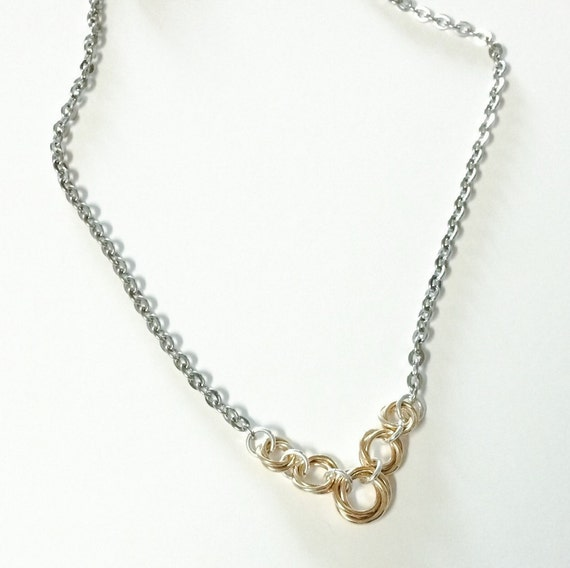 Infinity gold filled and stainless steel graduated flower necklace