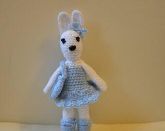 White bunny rabbit, soft toy, amigurumi doll, rabbit in a dress