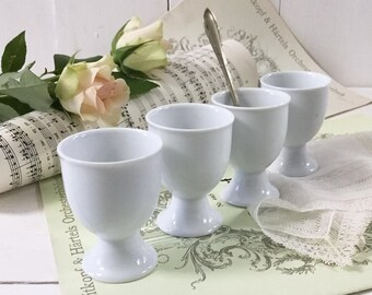 Porcelain egg cups. 4 French vintage Coquetiers. White porcelain egg cups. French Country Farmhouse. French antique Kitchenware. Breakfast