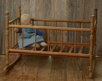 ROCKING DOLL BED-An Old Wood Doll Bed, with the mattress slat frame and turned corner pieces.
