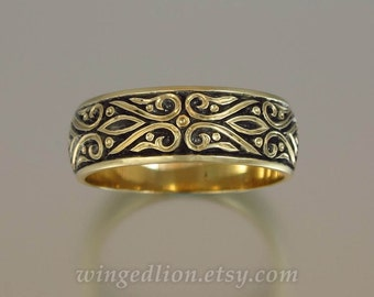 The PRINCE CHARMING 14K gold mens wedding band